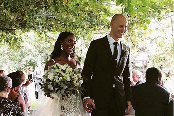 bride and groom walking down grape arbor aisle