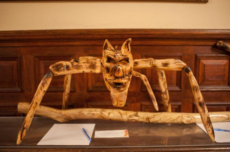 carved wooden spider