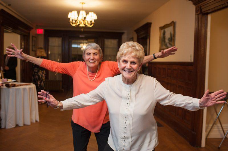 older ladies dancing in the foyer