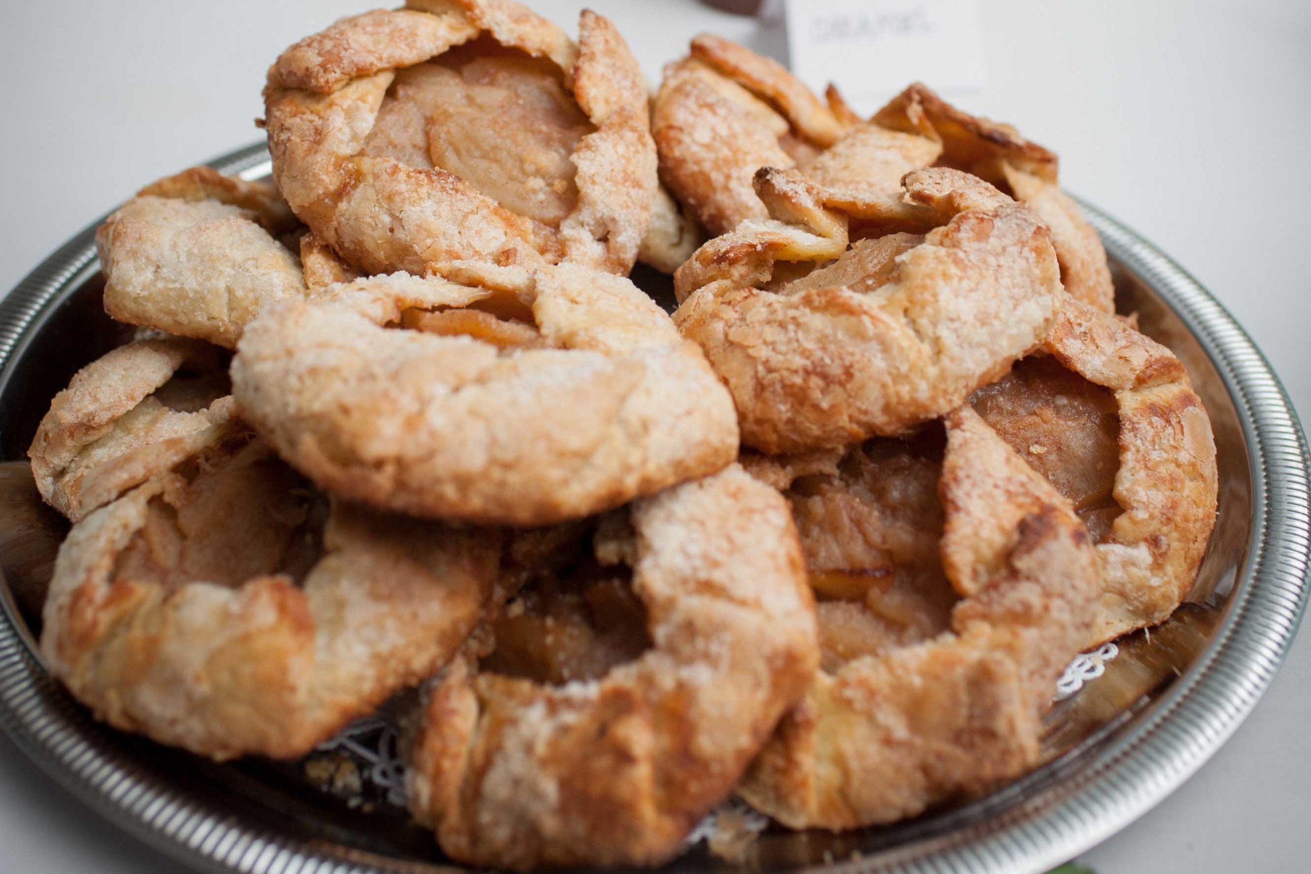 apple tarts piled on plate