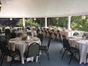 veranda set up with guest seating and the head table
