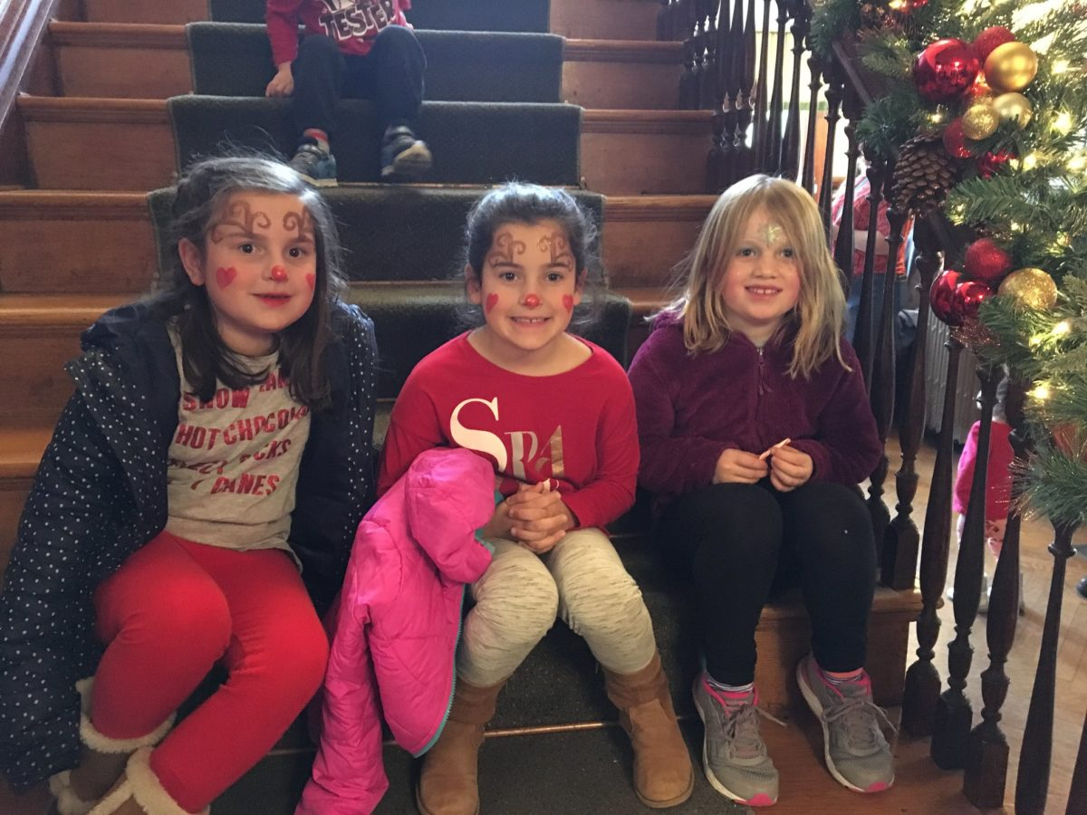 candy-cane-fundraiser-three-young-girls-sit-for-a-break-on-stairs