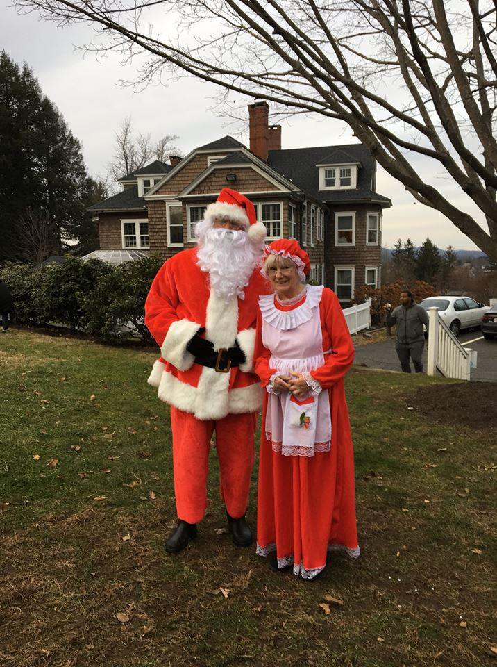 candy-cane-hunt-mr-mrs-claus-together-on-lawn