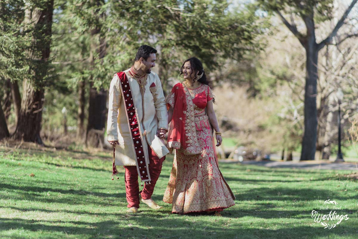 bride-groom-walking-dressed-in-traditional-indian-wedding-clothing