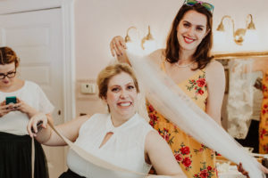 jewish-wedding-bride-getting-hair-done-while-bridesmaids-ready-to-help