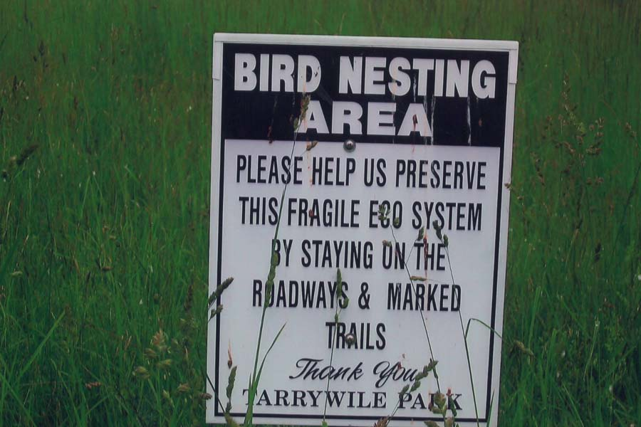 bird-nesting-area-sign-in-hayfields
