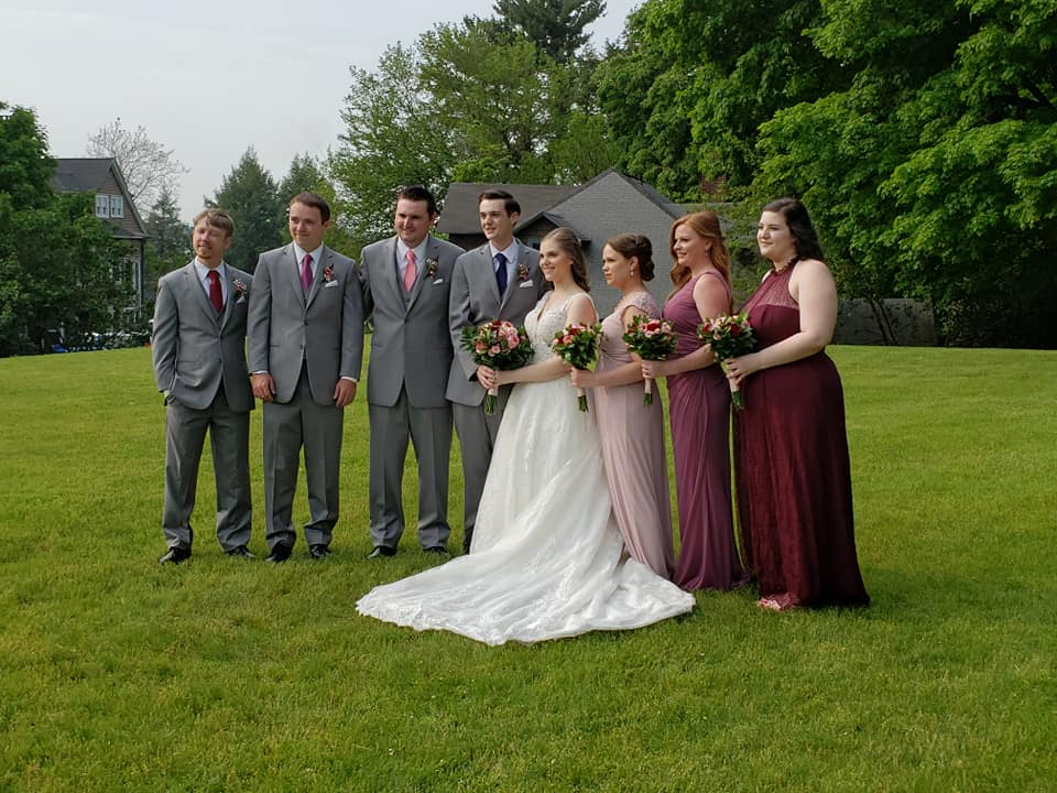 casual-wedding-party-together-on-lawn