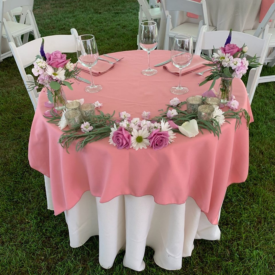 july-tent-wedding-head-table-pink-with-flowers