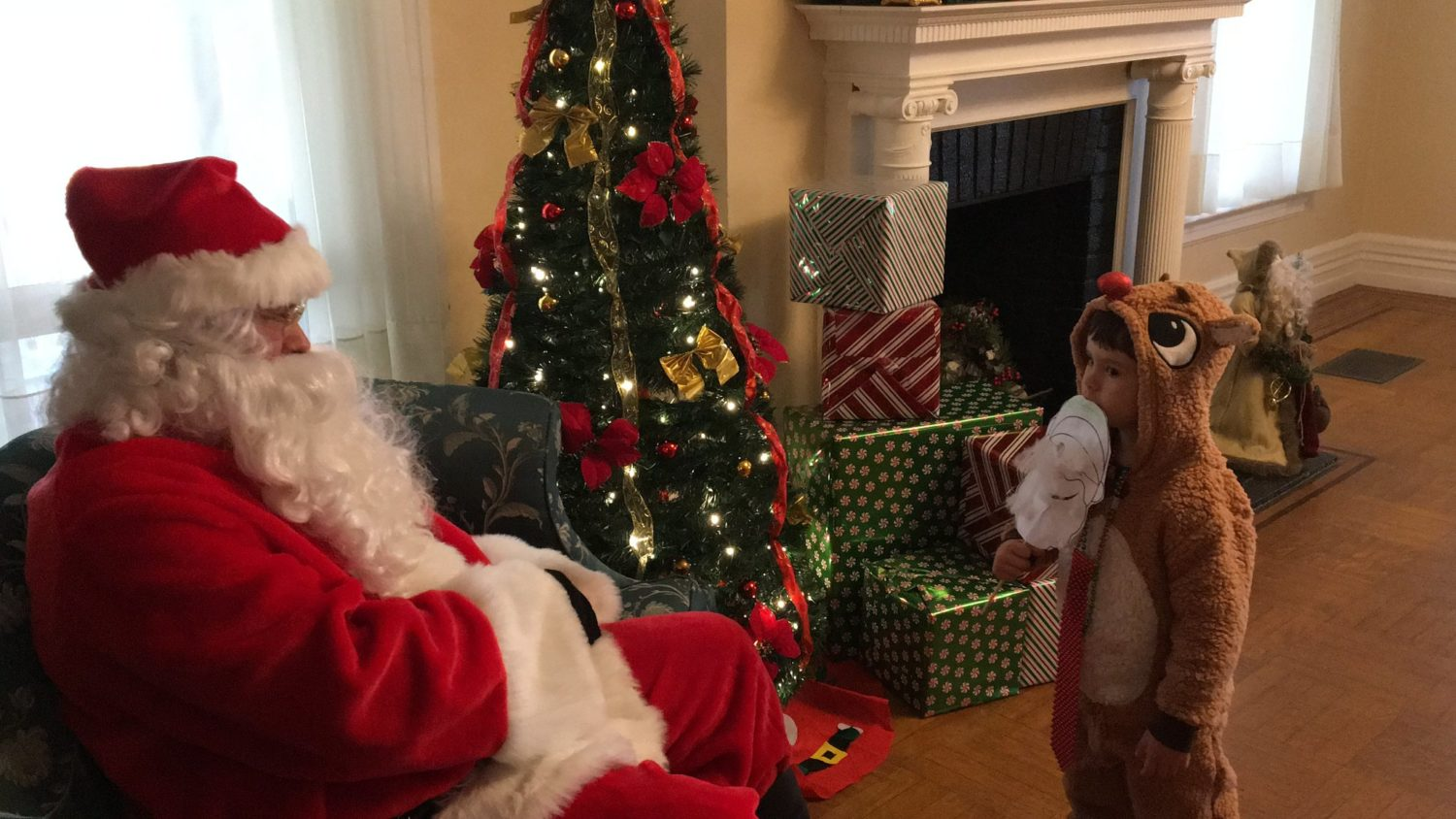 santa-with-child-in-reindeer-costume