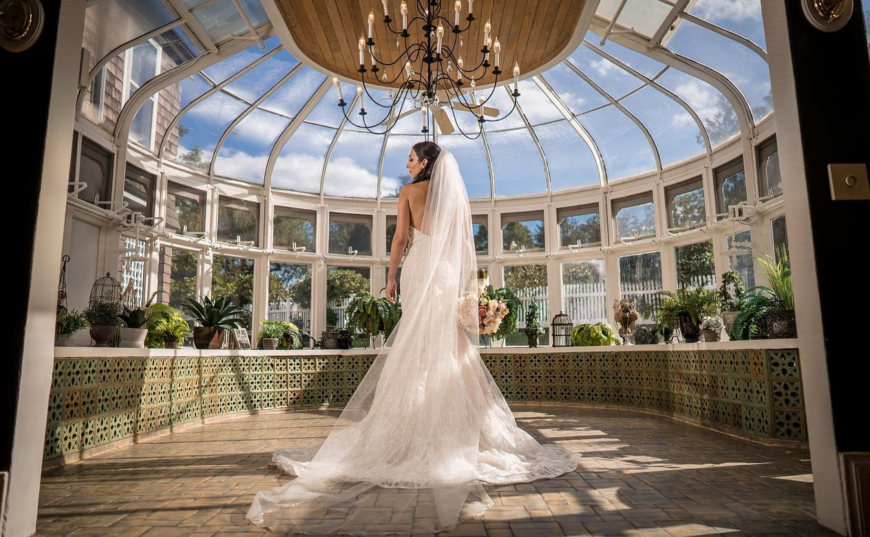 summer-first-look-bride-in-glass-conservatory