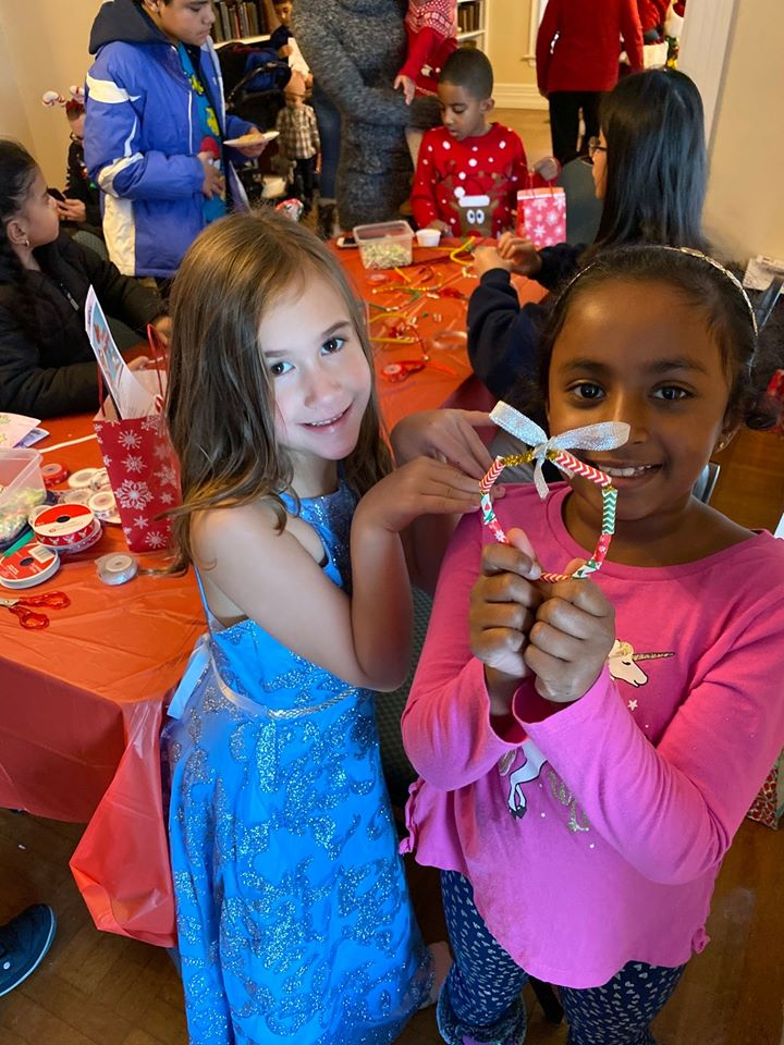 candy-cane-wreath-craft-held-by-two-young-girls