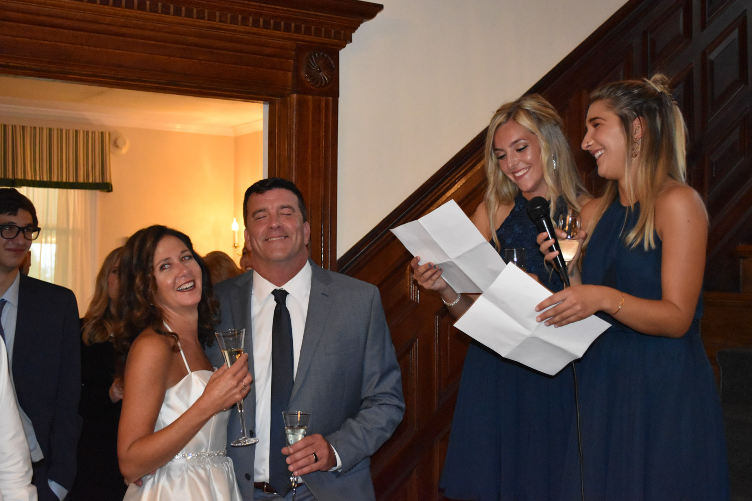 september-newlyweds-laughing-at-daughters-speech