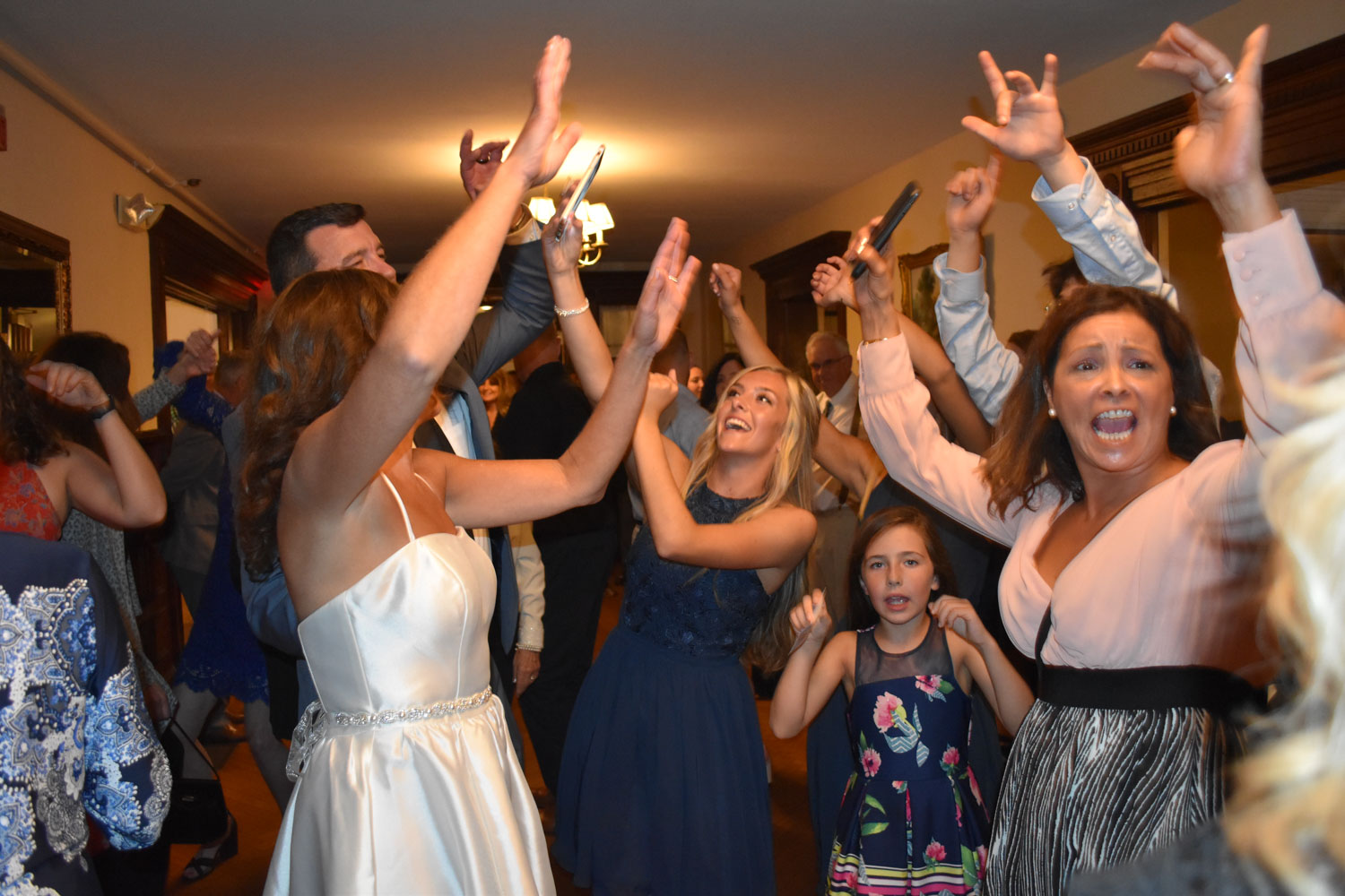 wedding-reception-dancing-guests-with-arms-raised
