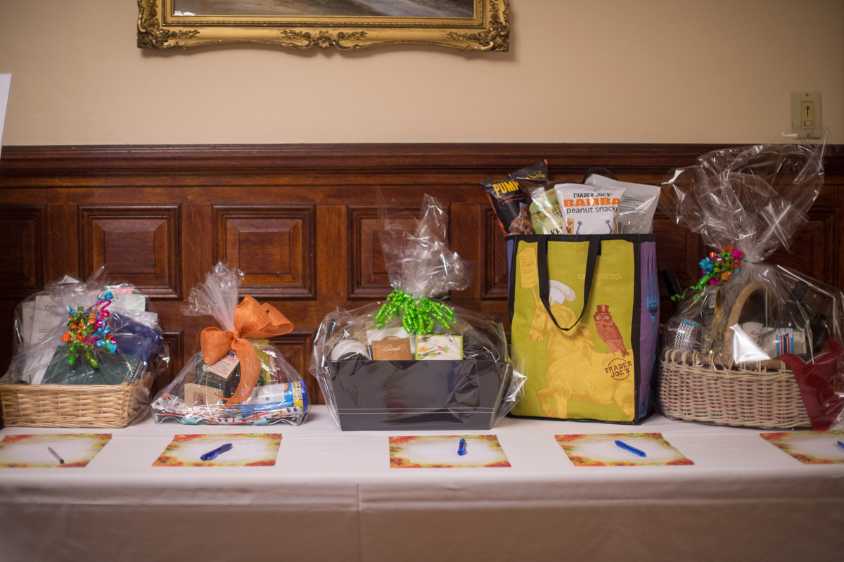 harvest dinner silent auction table with baskets of prizes