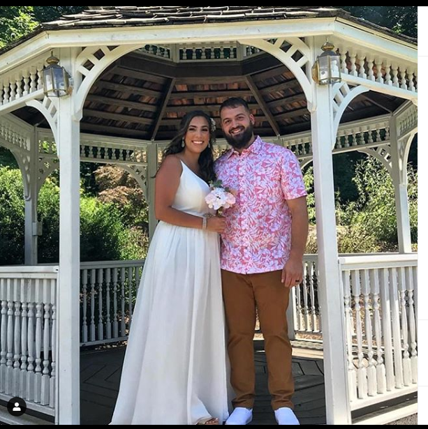 couple standing together at gazebo