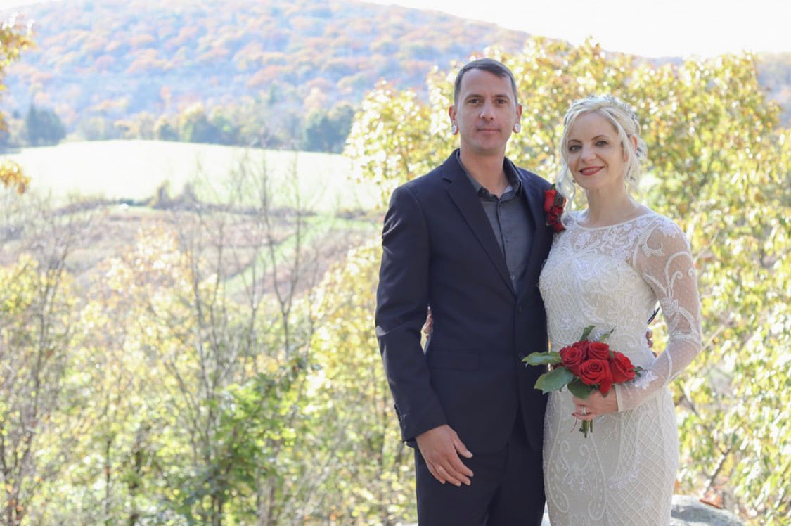 greg and julia with hayfields in background