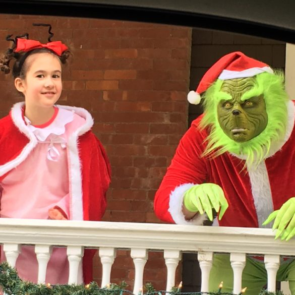 the grinch and cindy lou who greet you from the veranda