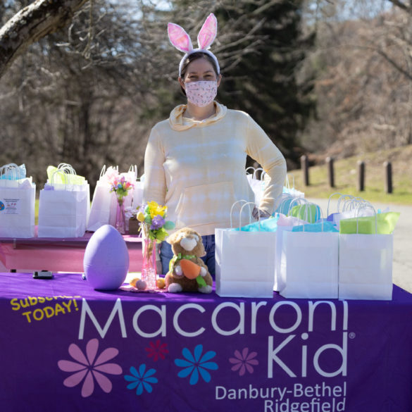 meghan with bunny ears behind table with goodie bags