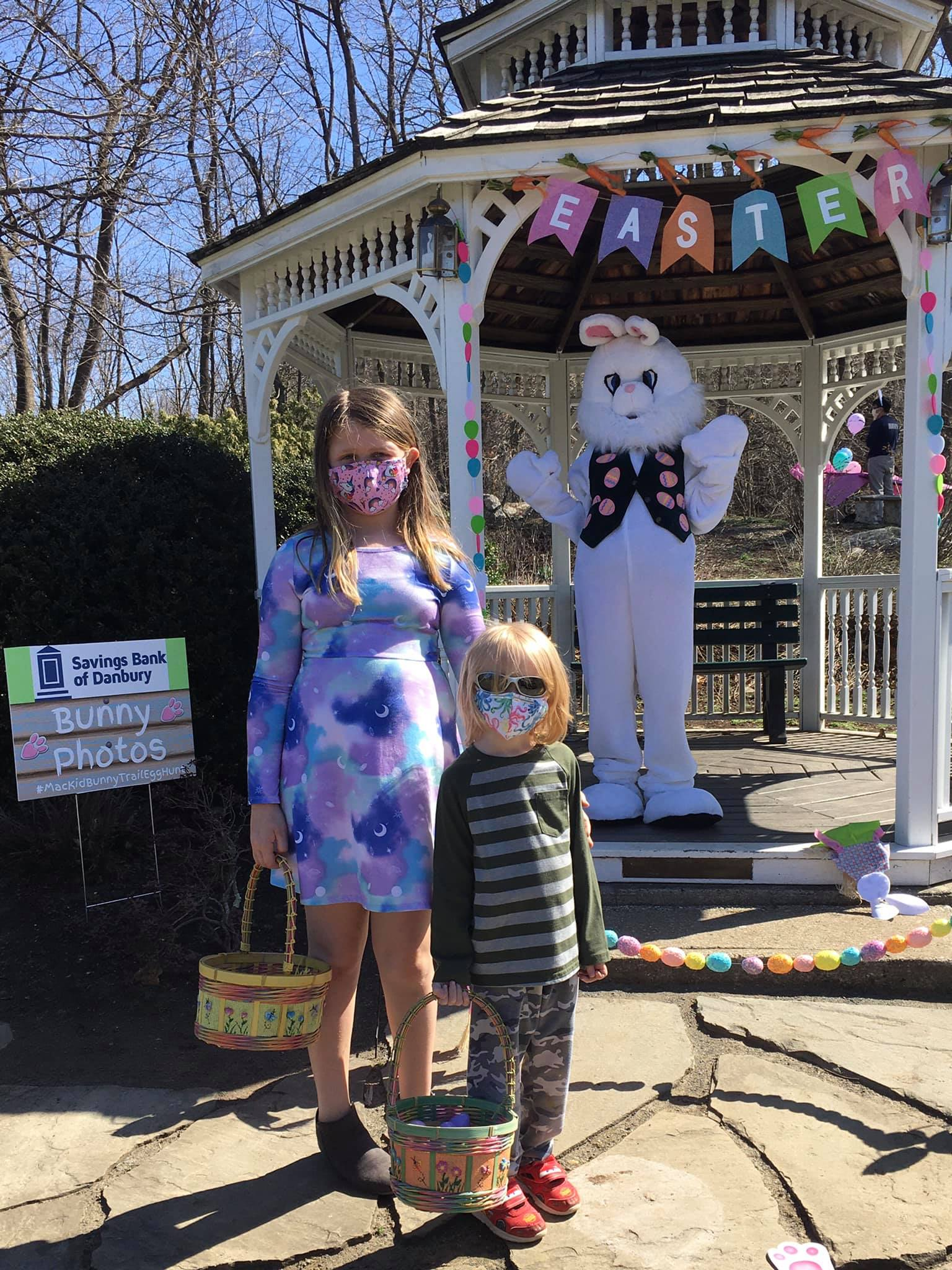 girl and boy standing with easter bunny